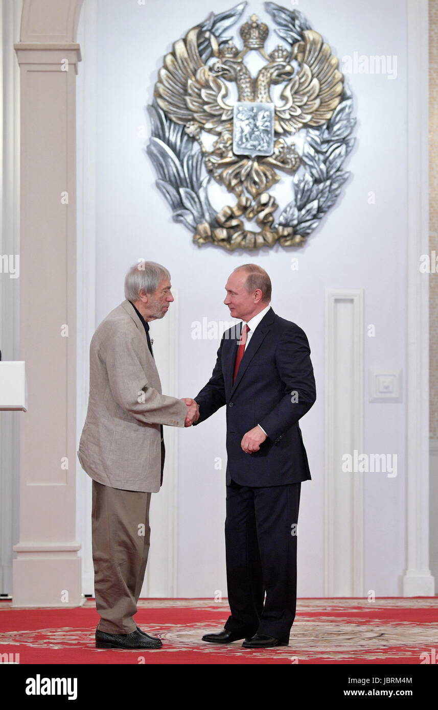 Moscow, Russia. 12th June, 2017. Composer Eduard Artemyev (L), who has received a national award, and Russia's President Stock Photo