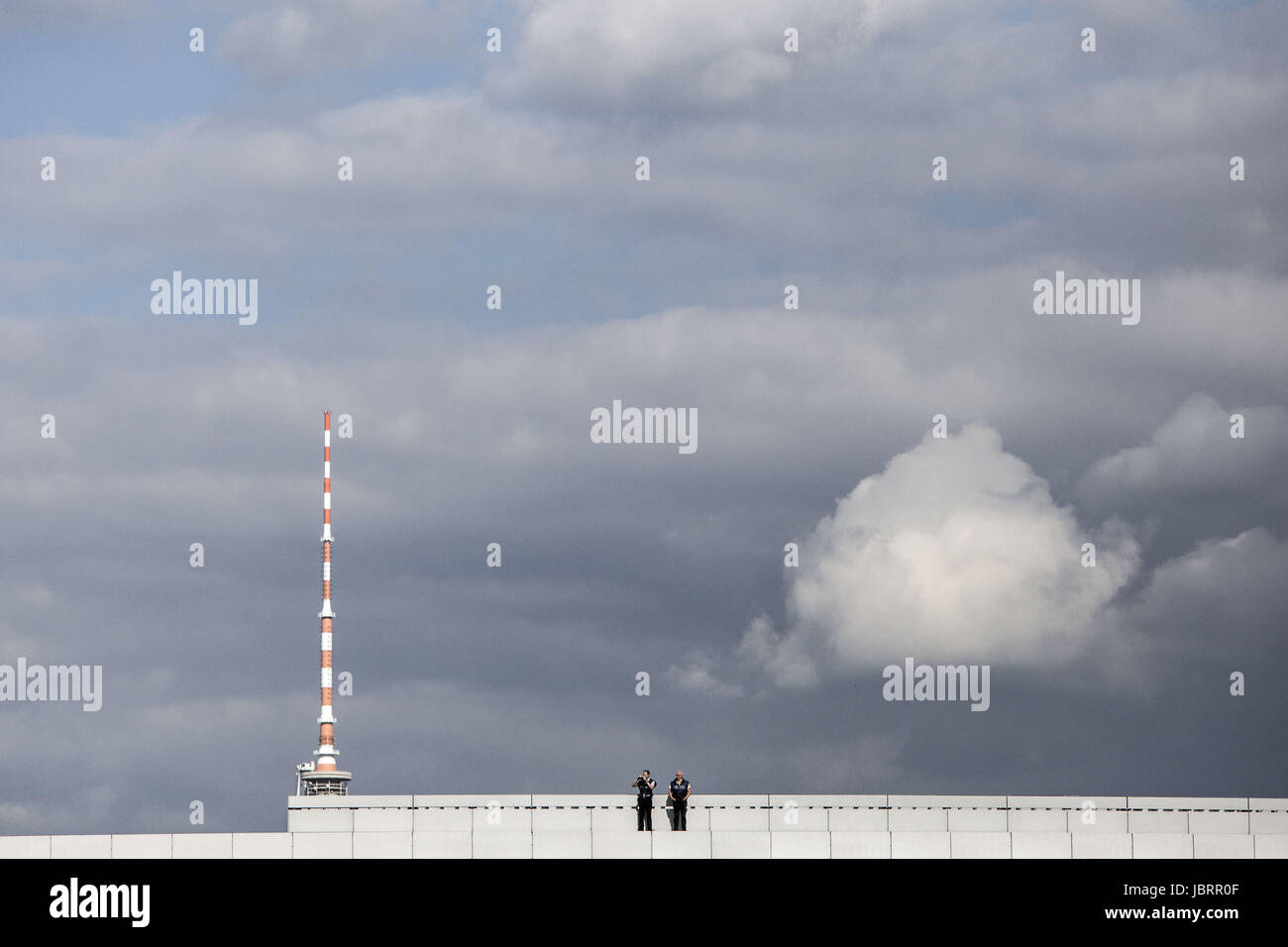 Berlin, Germany. 12th June, 2017. Two German policemen are seen at an observation post on the roof of the Paul-Löbe - Stock Image