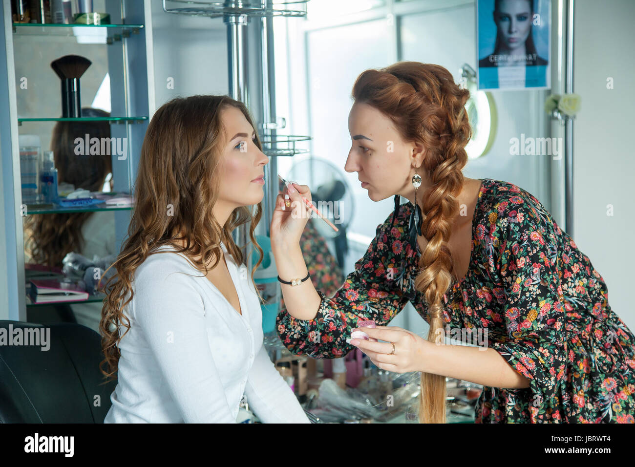 Make up artist do a professional makeup - Stock Image