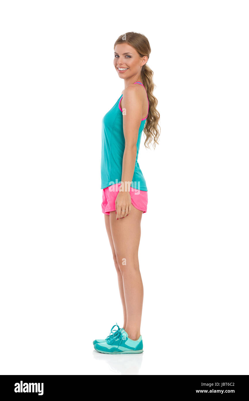 c981b6ff779537 Cheerful beautiful young woman in pink shorts