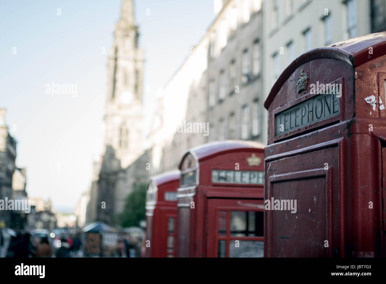 Three phone boxes in a row - Stock Image