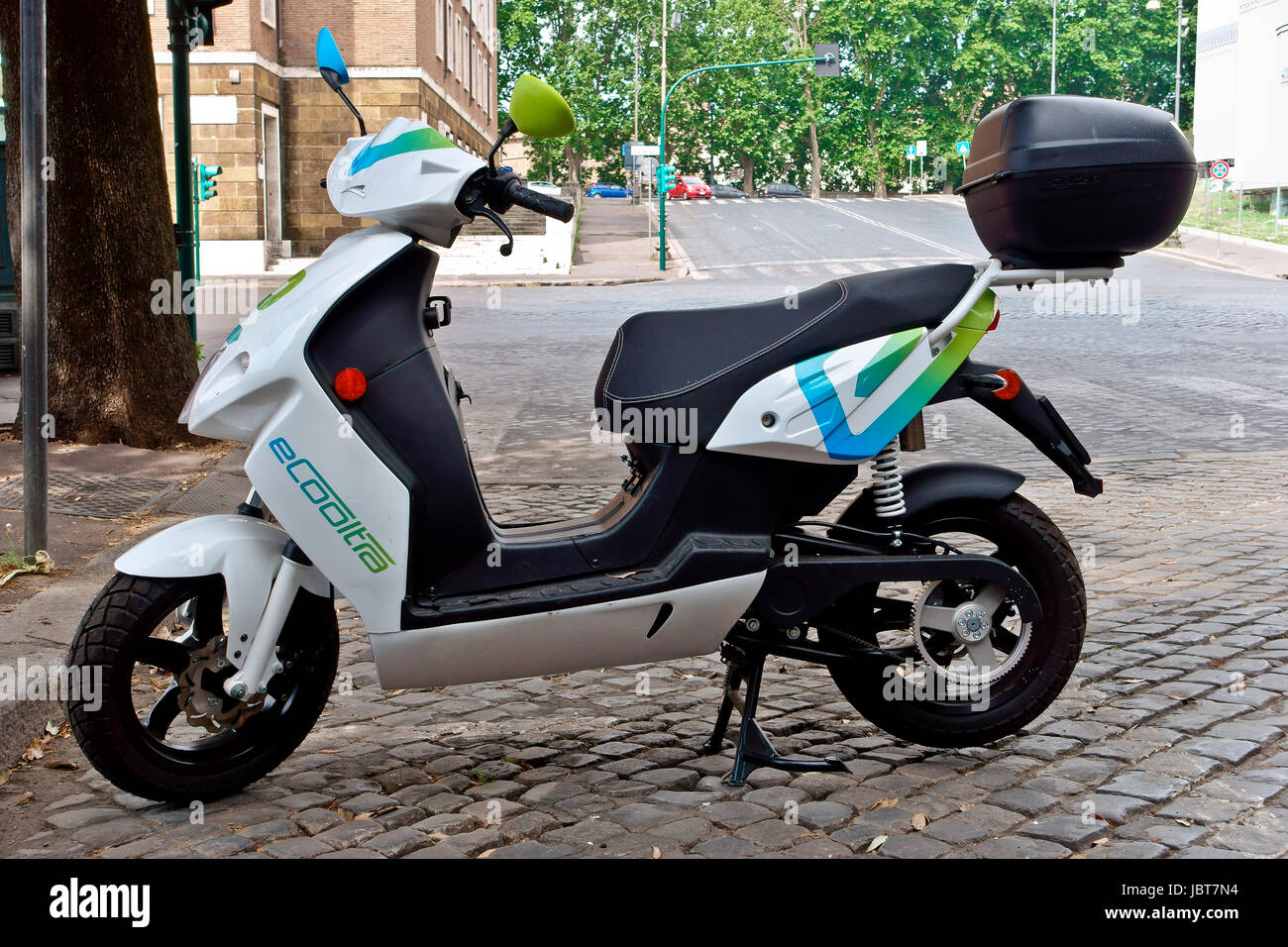 Ecooltra electric scooter sharing parked perpendicularly. Environment, e-mobility, emission-free, eco-friendly, Stock Photo