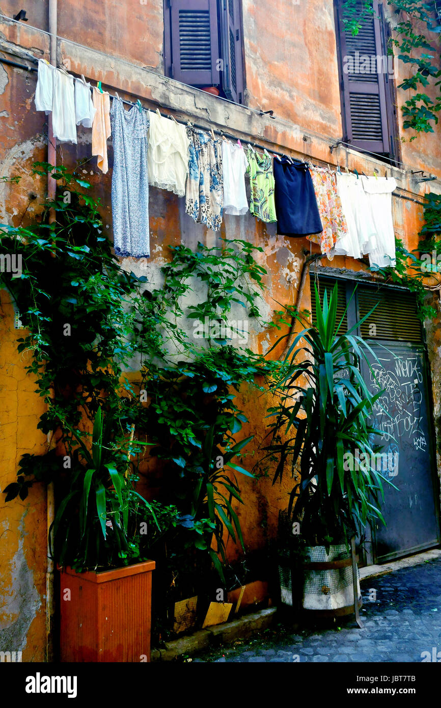 laundry line with clothes in a typical roman alley, Trastevere neighborhood, Rome, Italy - Stock Image