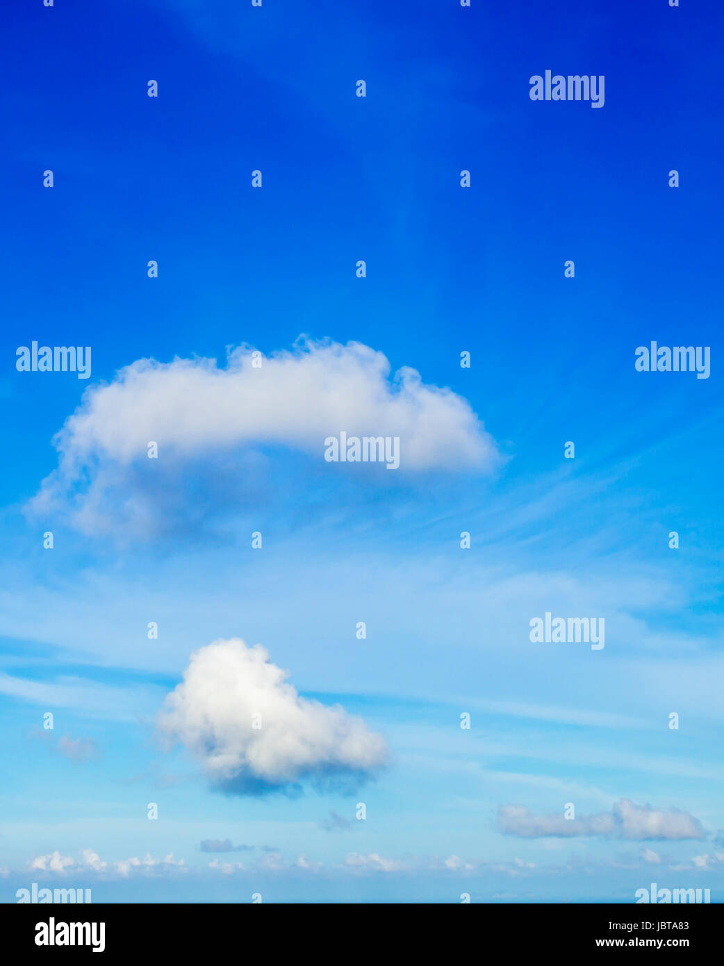 Closeup blue sky and fluffy clouds background - Stock Image