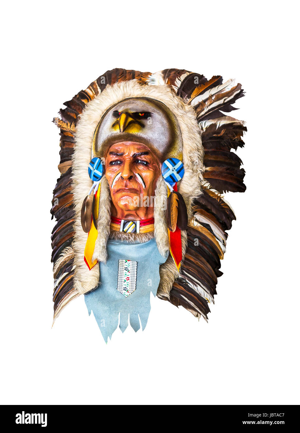 Wood carved indian chief head isolated on white with clipping path - Stock Image