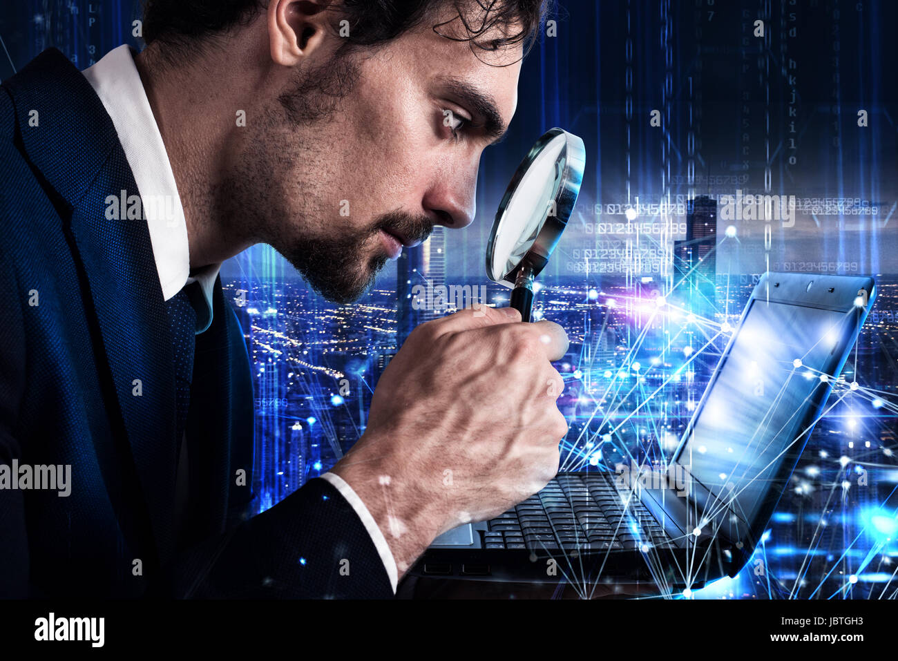 Man looks at the magnifying glass a laptop. Concept of software analysis - Stock Image