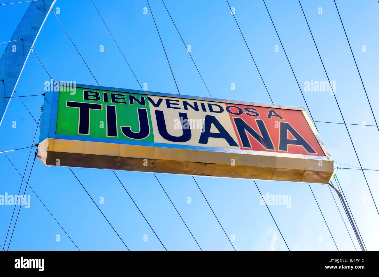 The Bienvenidos a Tijuana sign on the Millennial Arch (Arco y Reloj Monumental), a metallic steel arch at the entrance - Stock Image
