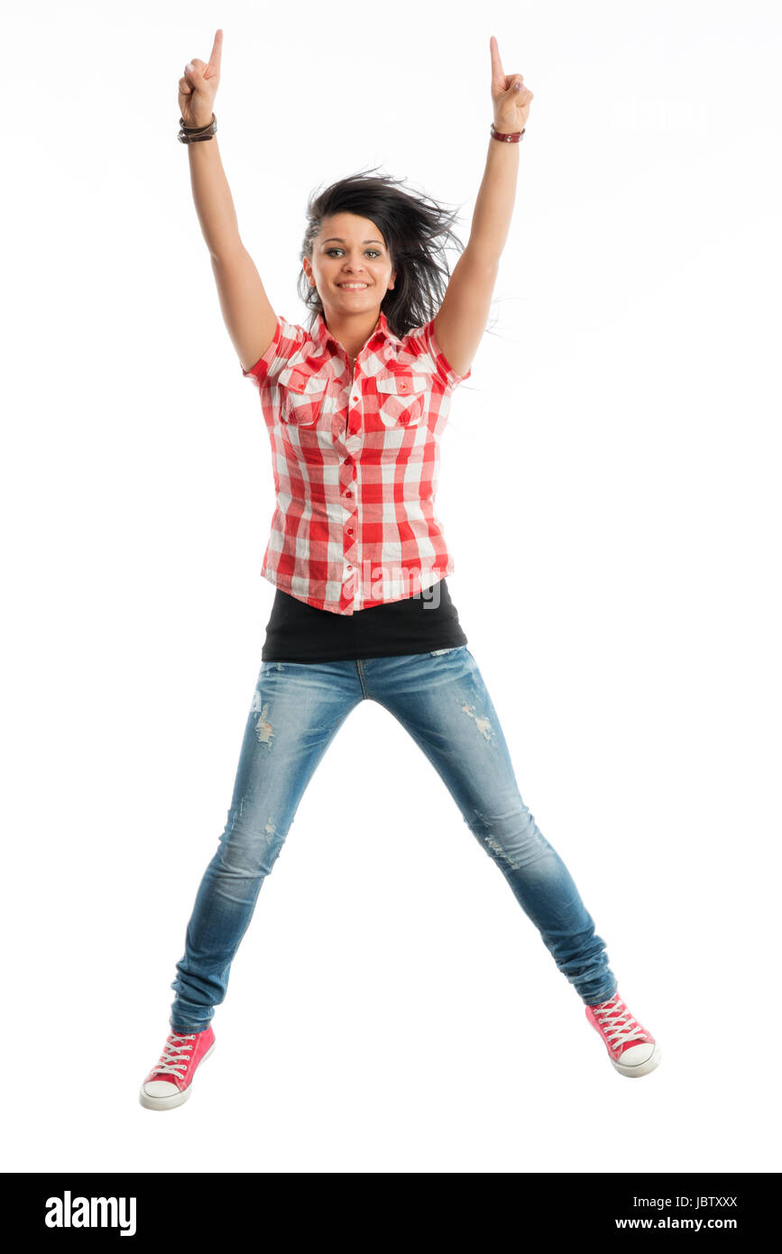 young girl jumping for joy in the air - Stock Image