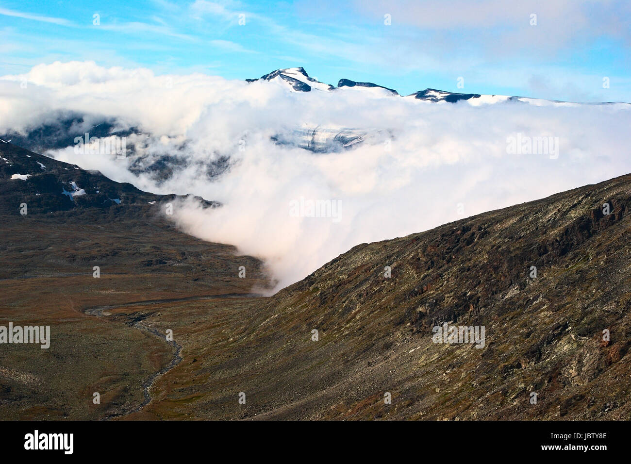 View onto Galdhopiggen from the path to Glittertind in the Jotunheimen National Park in Norway. Galdhopiggen is - Stock Image