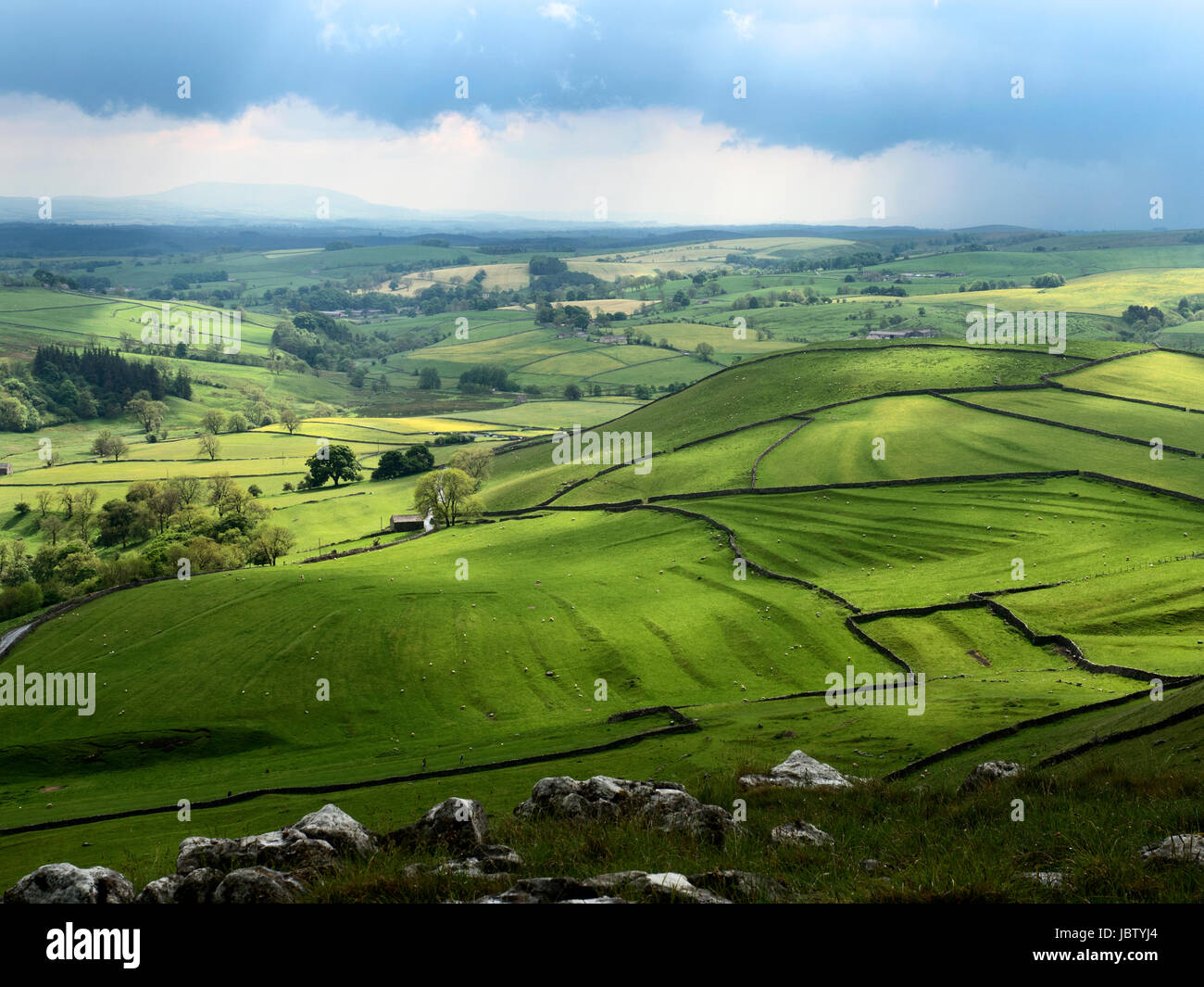 Light on Meadows in Malhamdale after a Thunderstorm from above Gordale Scar Malham North Yorkshire England - Stock Image