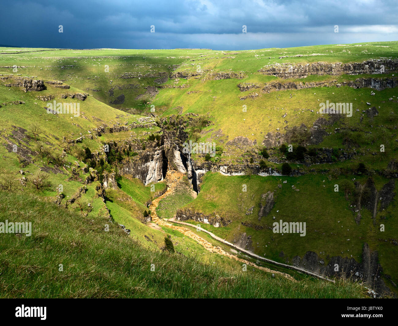 Sunlight on Gordale Scar after a Thunderstorm near Malham North Yorkshire England - Stock Image