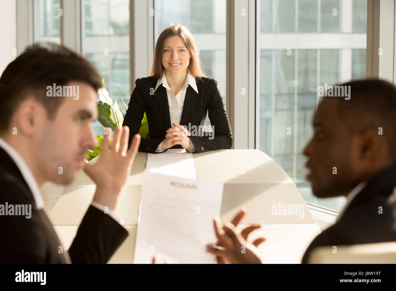 Worried nervous businesswoman waiting for result while recruiters reviewing resume, making hiring decision, unemployed - Stock Image