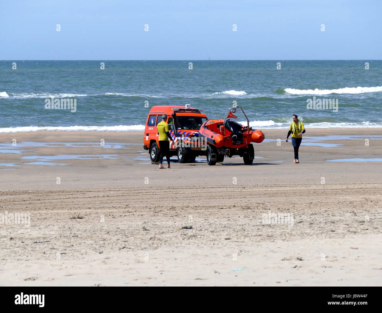 CASTRICUM, THE NETHERLANDS - JUNE 10, 2017: Speedboat, surf life saving vehicle and crew on the beach of the Dutch Stock Photo