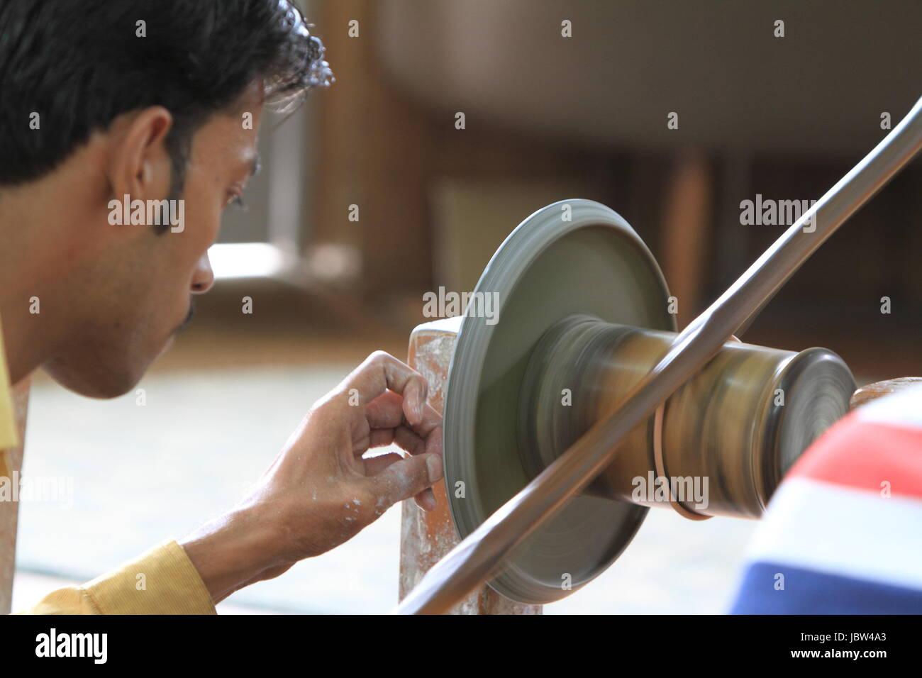 grind craftsmen at - Stock Image