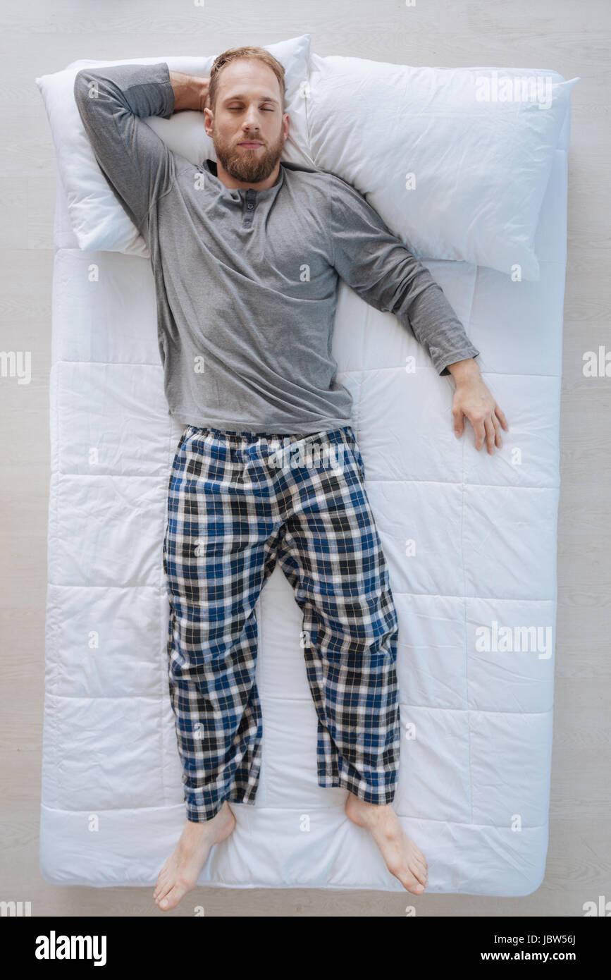 Handsome peaceful man sleeping - Stock Image