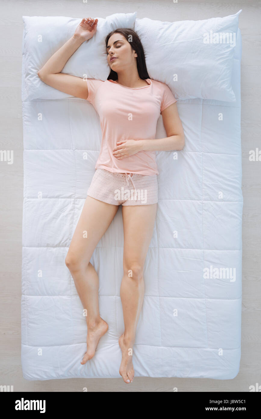 Attractive peaceful woman enjoying her sleep - Stock Image
