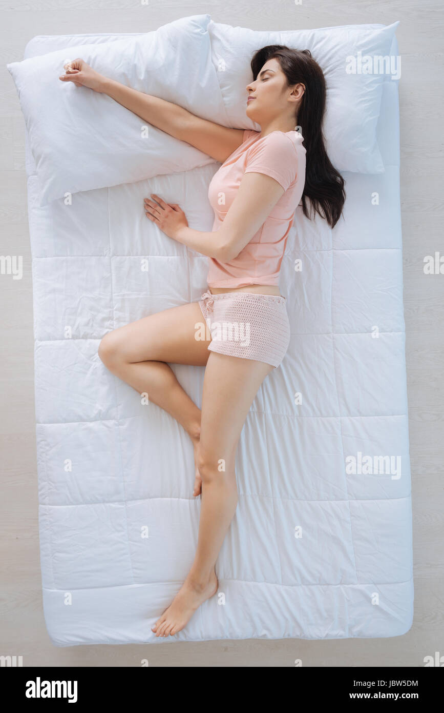 Attractive nice woman sleeping in her bed - Stock Image