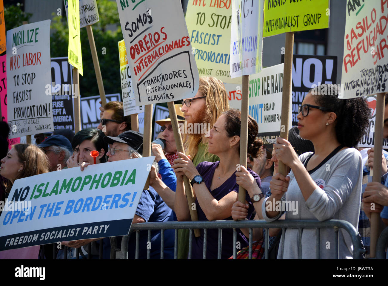 People at a counter protest to a anti-Sharia rally in New York City. - Stock Image