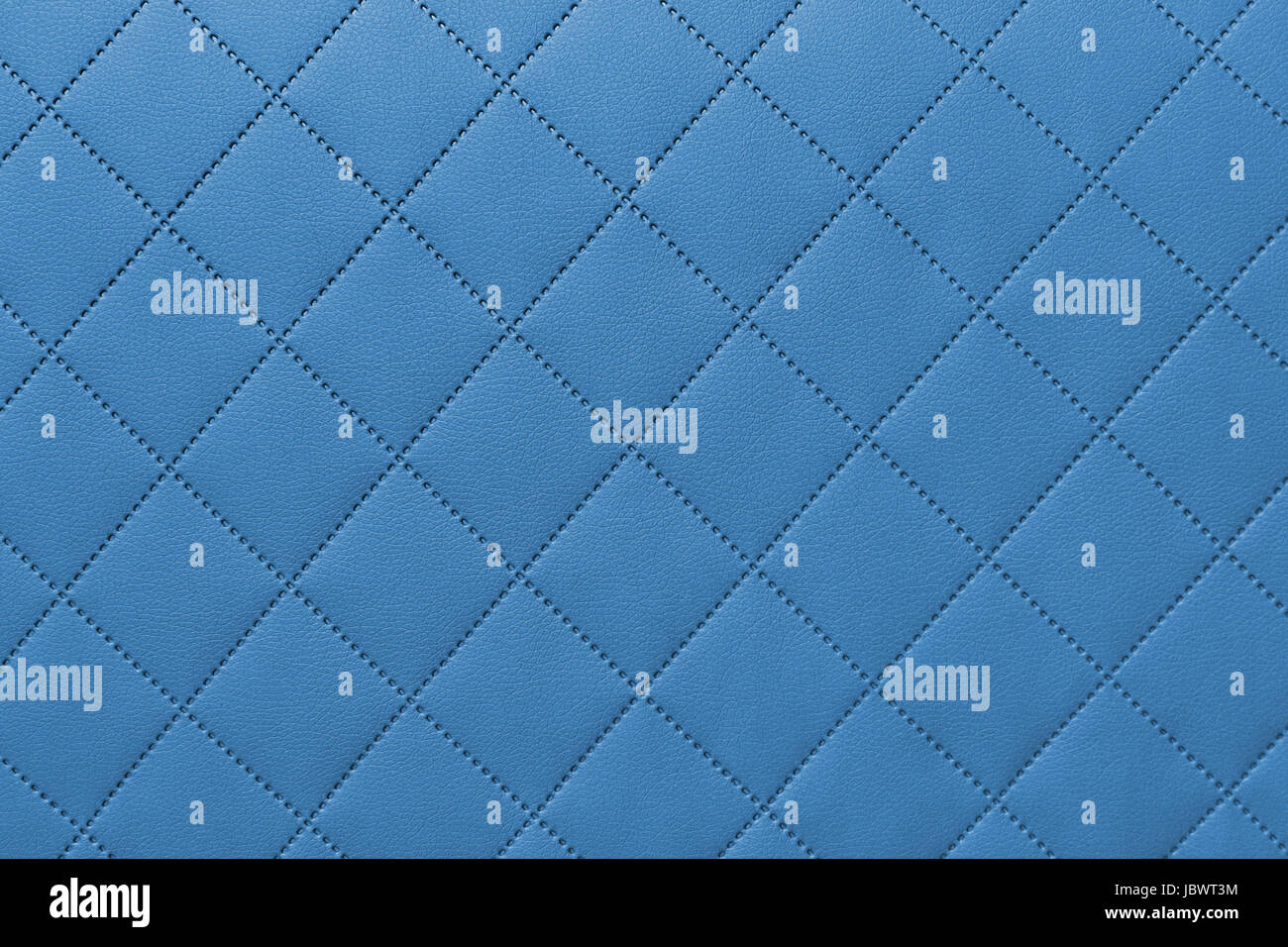 detail of sewn leather, blue leather upholstery background pattern - Stock Image