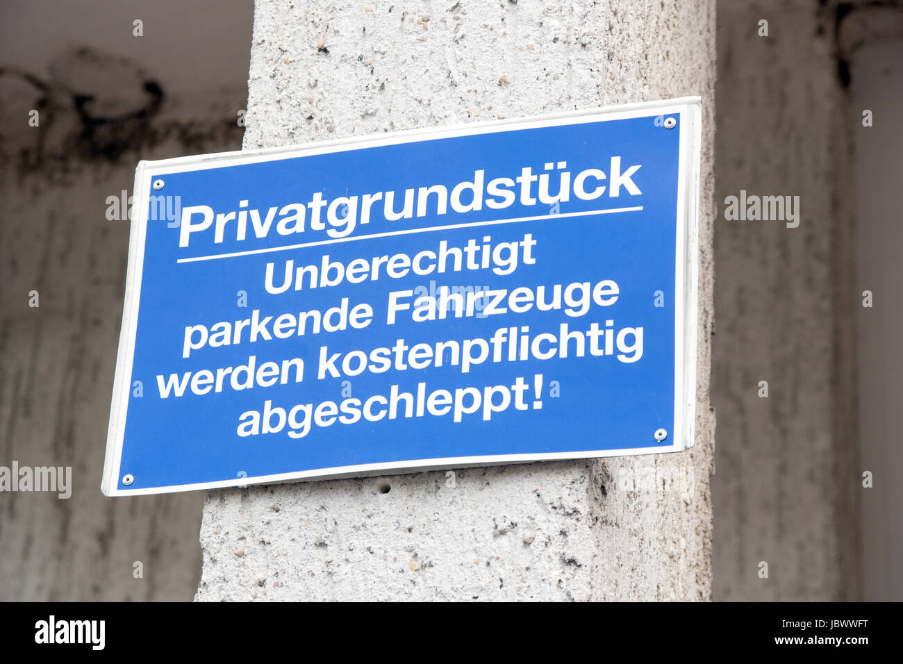 blue sign with the german words private land - Stock Image