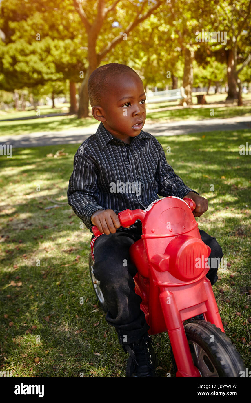 f1a472893a2 Child Motorcycle Stock Photos & Child Motorcycle Stock Images - Alamy
