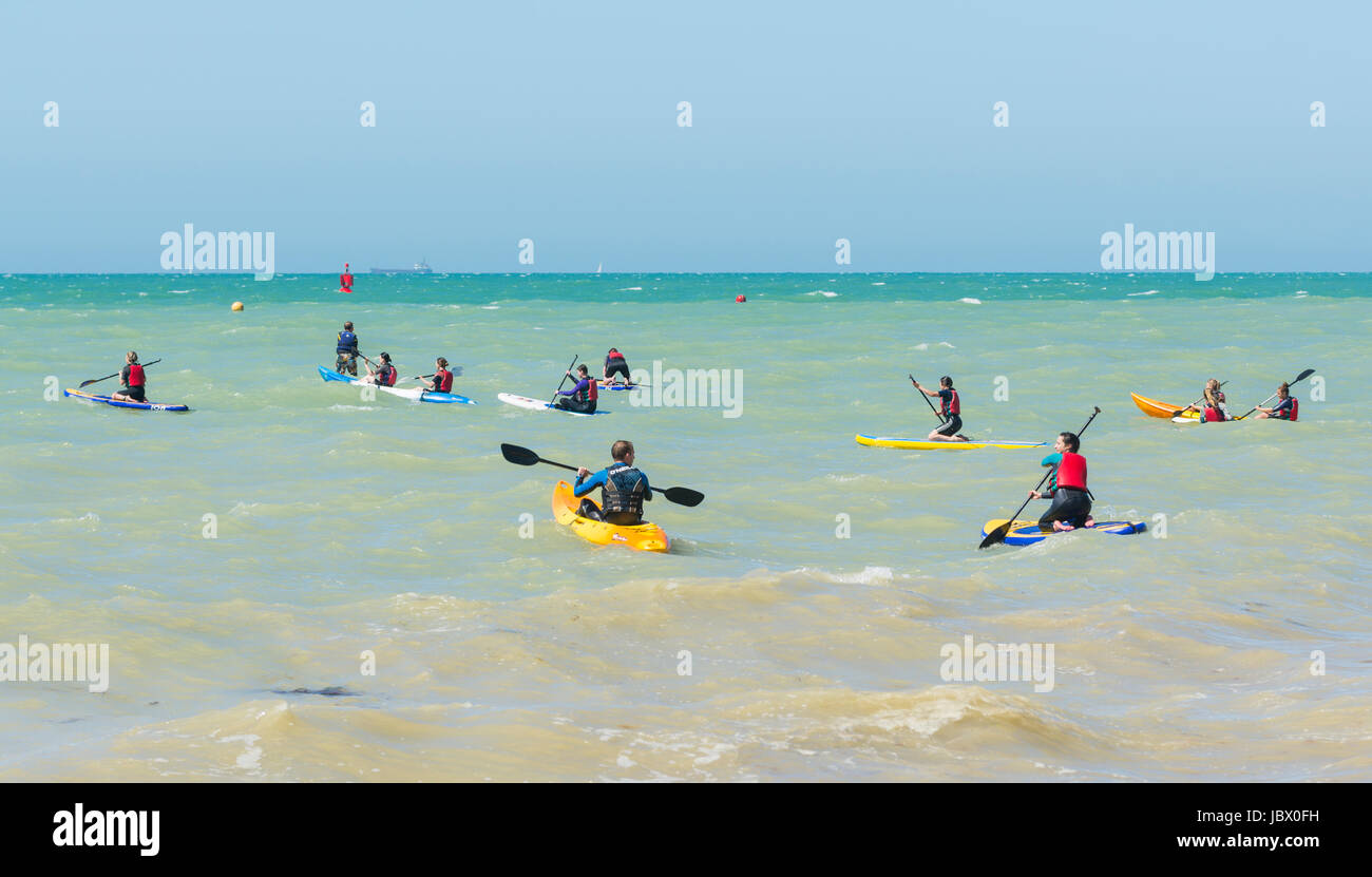 Kayakers. People paddling in kayaks on the sea in Brighton, East Sussex, England, UK. - Stock Image