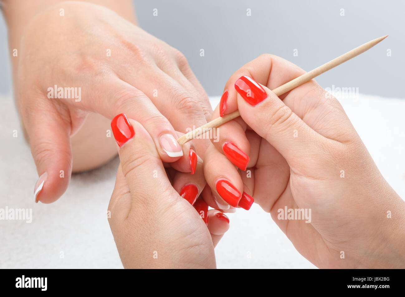 Cuticles care with cuticle pusher Stock Photo: 145016804 - Alamy