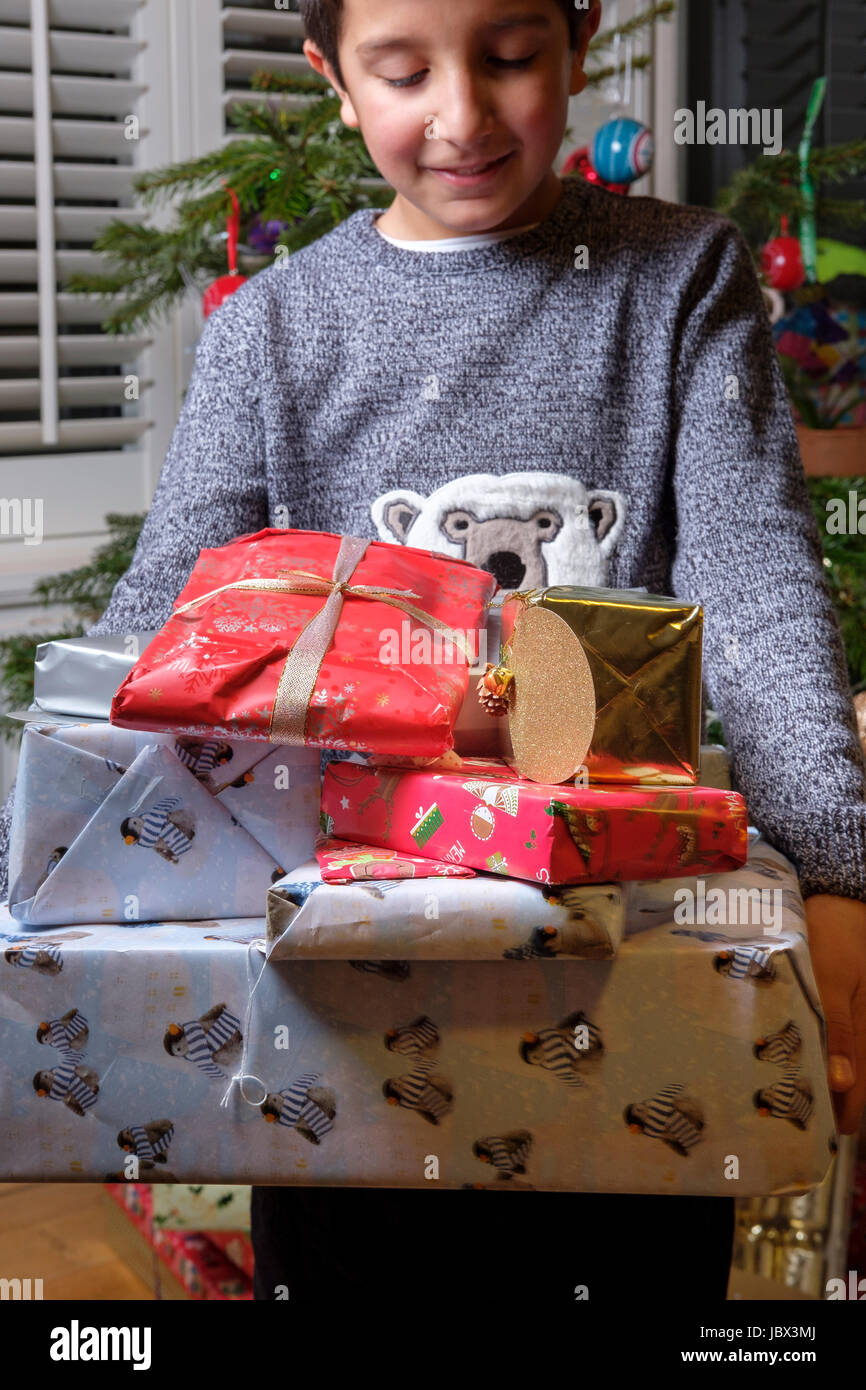 Boy,9 years old with Christmas presents Stock Photo: 145017842 - Alamy