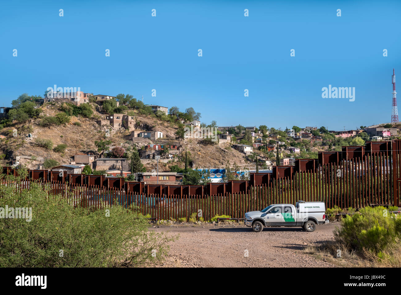 Border patrol in front of fence dividing USA and Mexico in Nogales, Arizona, USA; a matter of current politics and Stock Photo