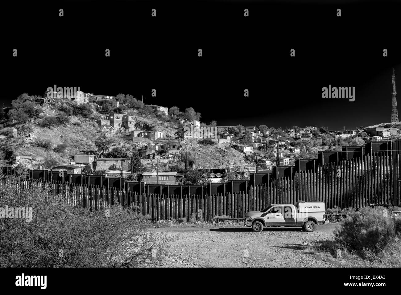 Border patrol in front of fence dividing USA and Mexico in Nogales, Arizona, USA; a matter of current politics and - Stock Image