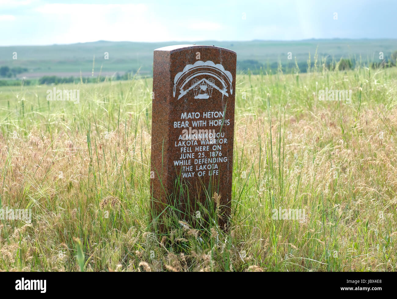 "A head stone marks the spot where Lakota warrior, ""Mato Heton""  ""Bear With Horns"" fell during the battle of Little Bighorn, Montana in 1876. Stock Photo"