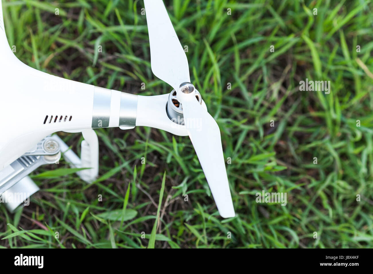 quadcopter outdoors, aerial imagery and tech hobby, recreation concept - rotor of white quadrocopter before flight - Stock Image