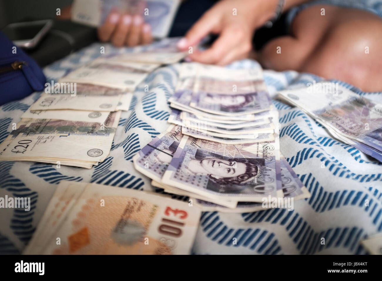 Person countin money-UK pound sterling - Stock Image