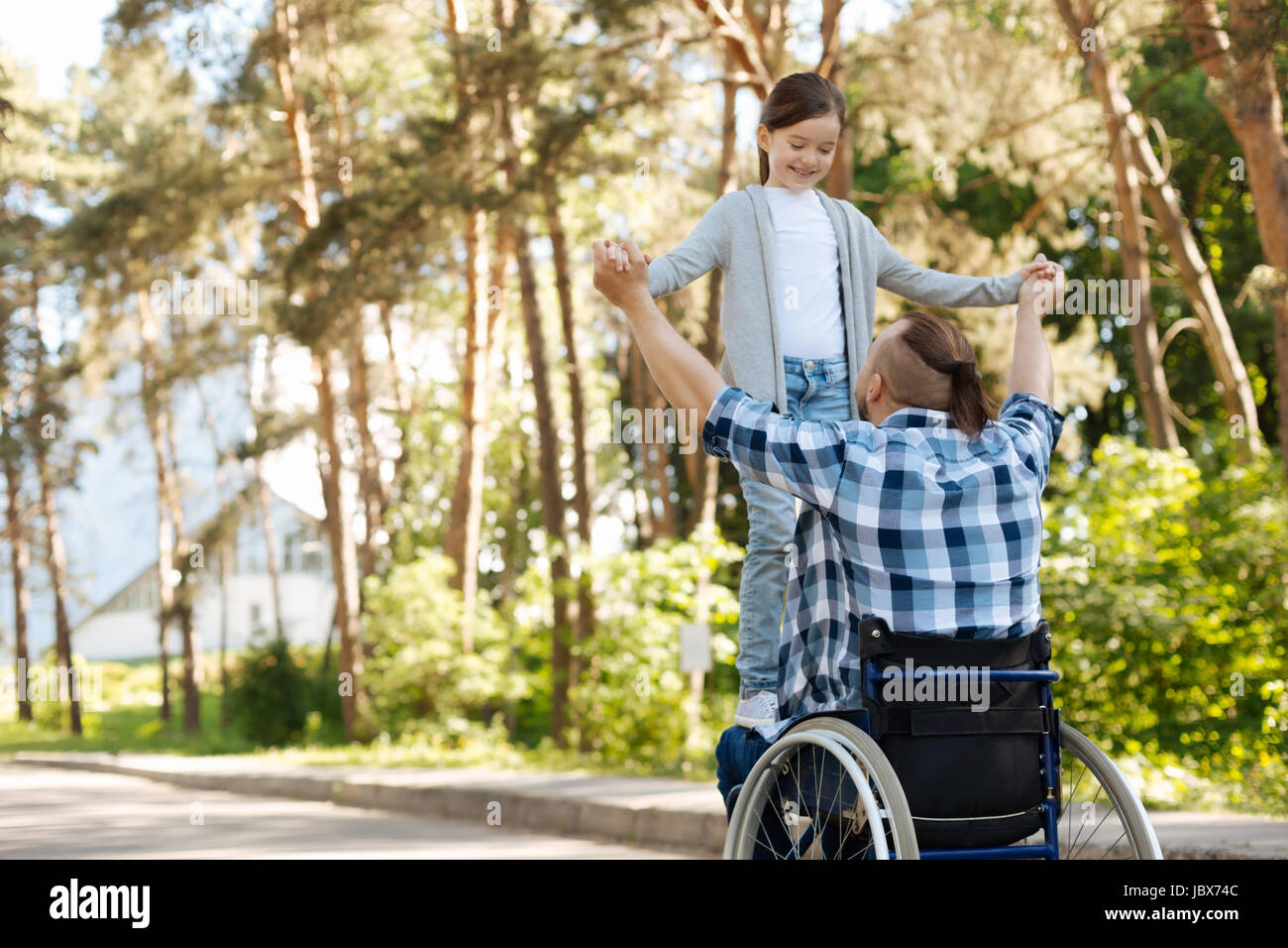 Attractive little female playing with her dad - Stock Image