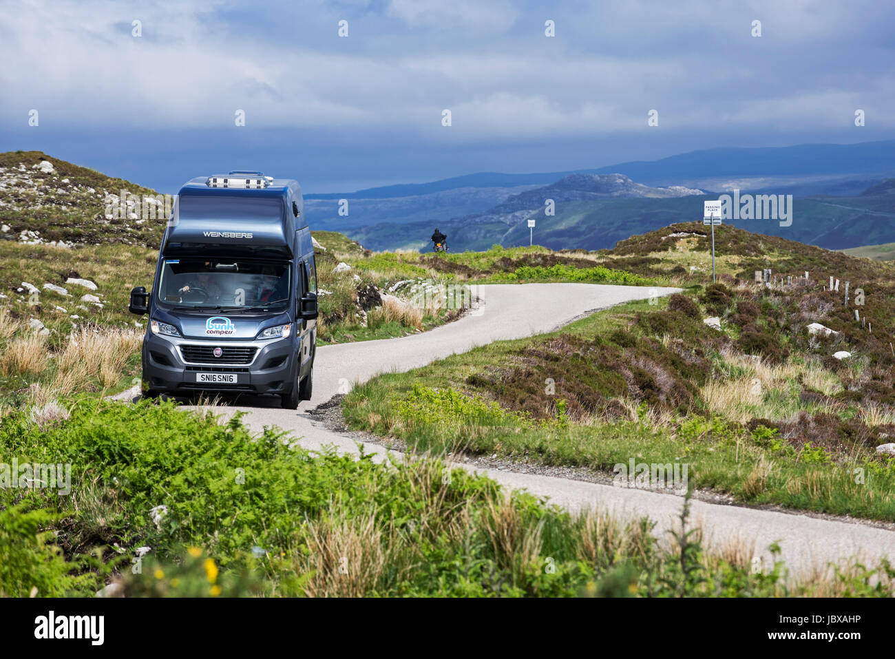 Motorhome at passing place on winding single track road in the Scottish Highlands, Scotland, UK - Stock Image