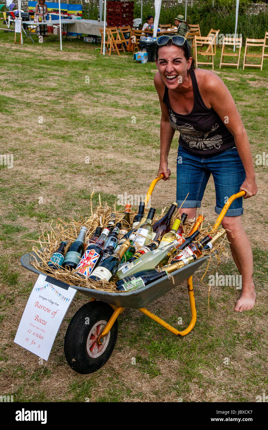 A Woman Wins The 'Barrow of Booze' At The Jevington Fete, Eastbourne, Sussex, UK - Stock Image