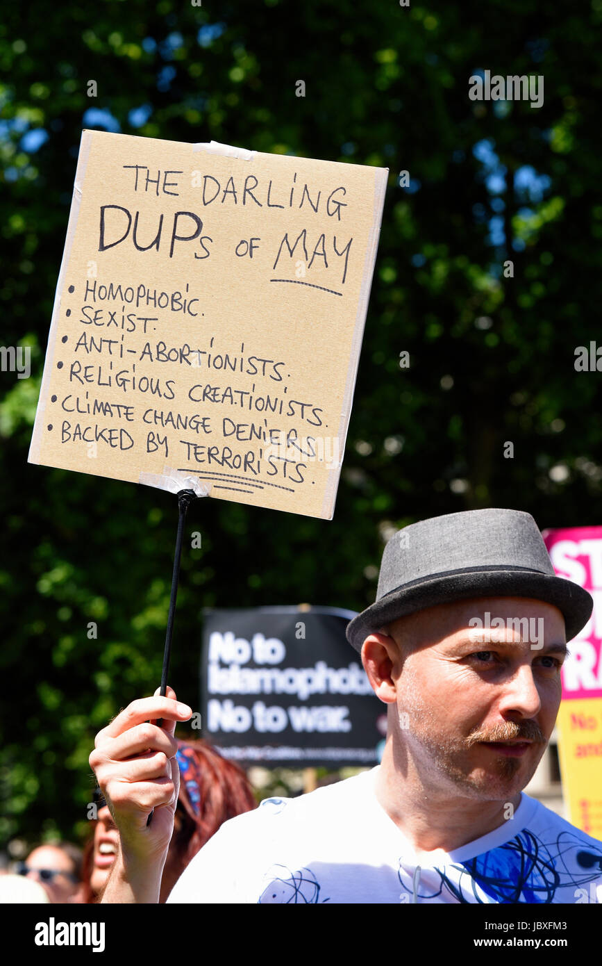 Demonstrators against the Tory DUP alliance gathered in Parliament Square and marched on Downing Street. London, - Stock Image