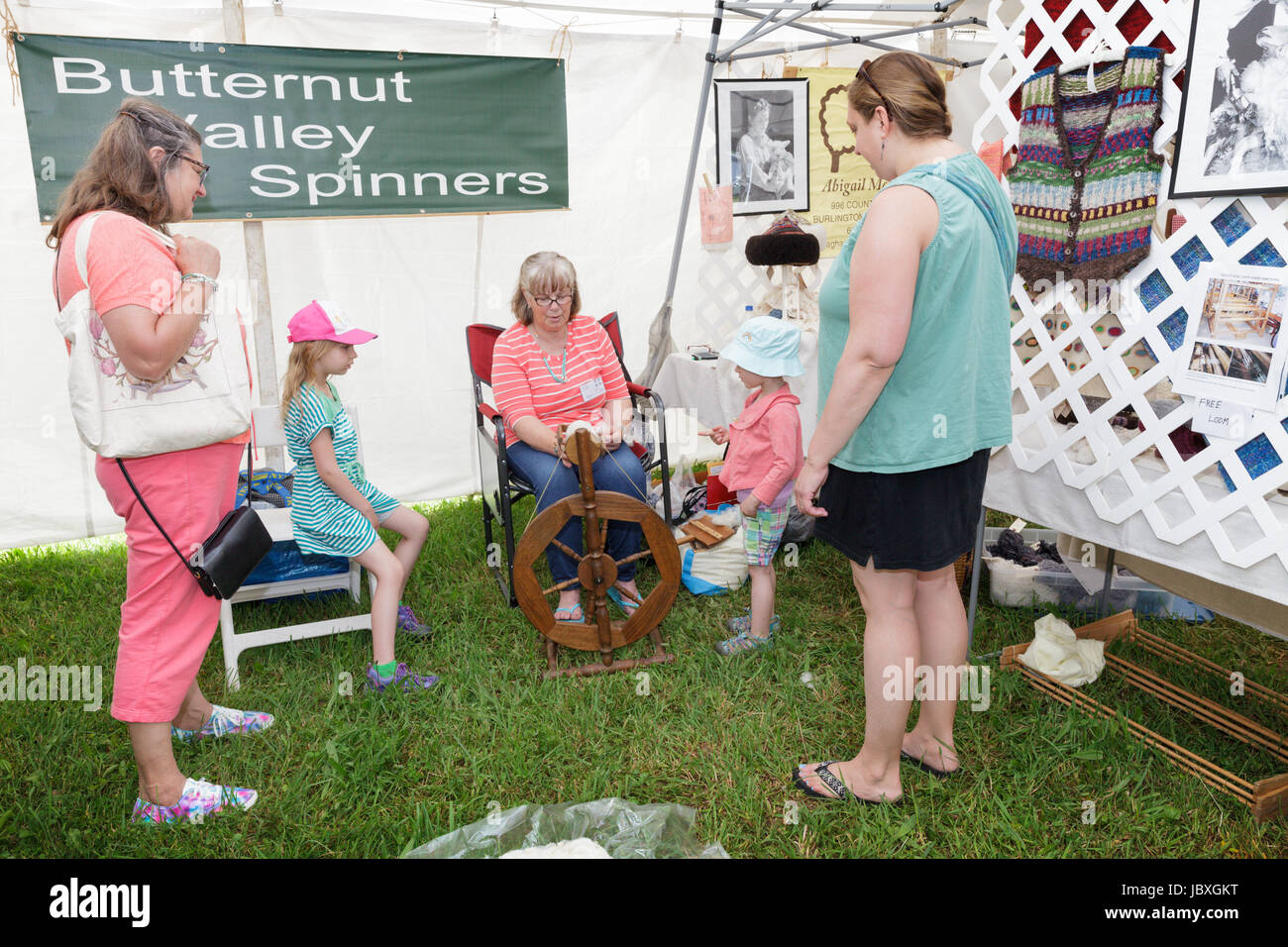 BOUCKVILLE, NY, USA - JUNE 10 2017: Women show little girls how to spin wool at the annual Fiber Festival of Central - Stock Image