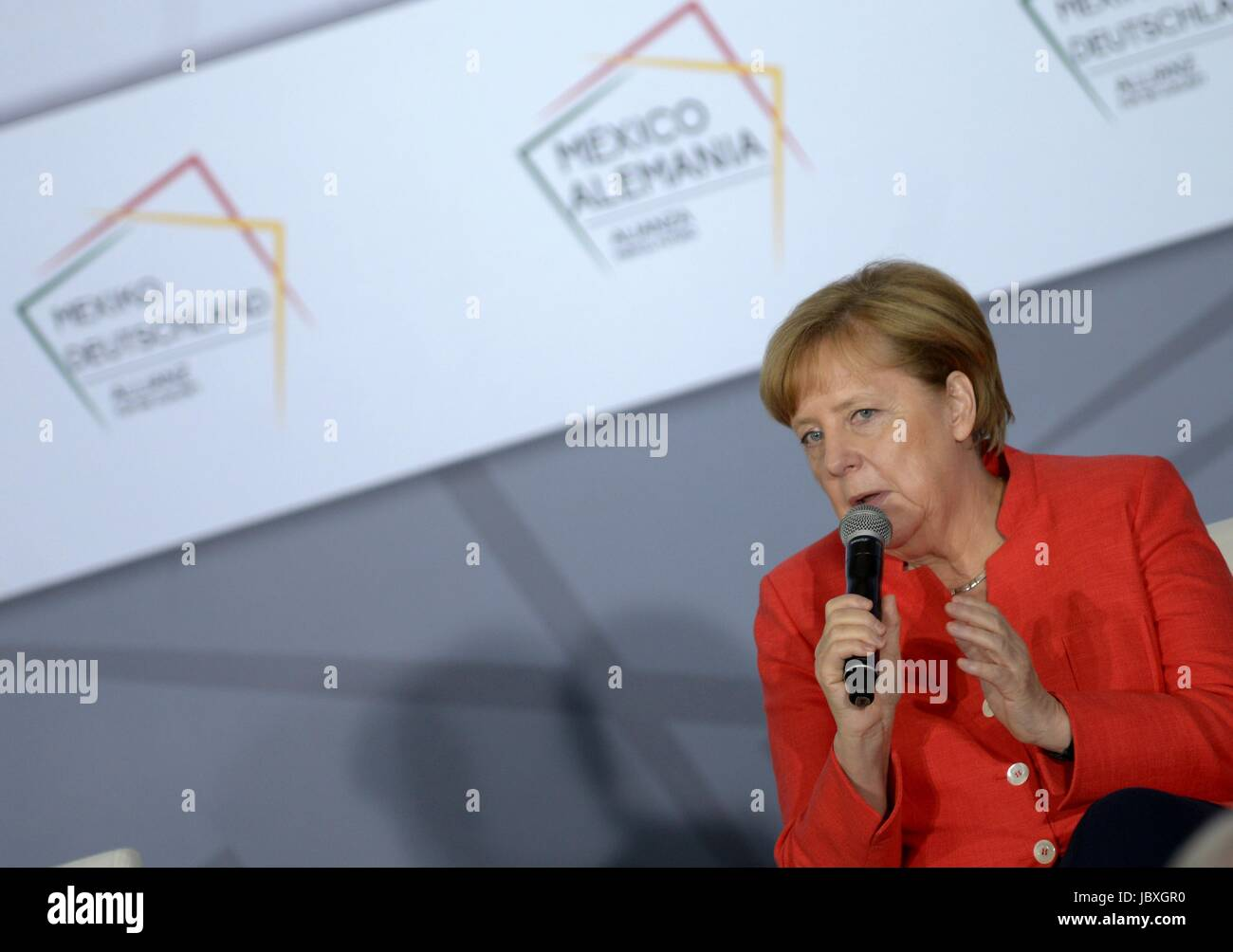 German Chancellor Angela Merkel speaks during a meeting with Mexican business leaders at the Interactive Economics - Stock Image