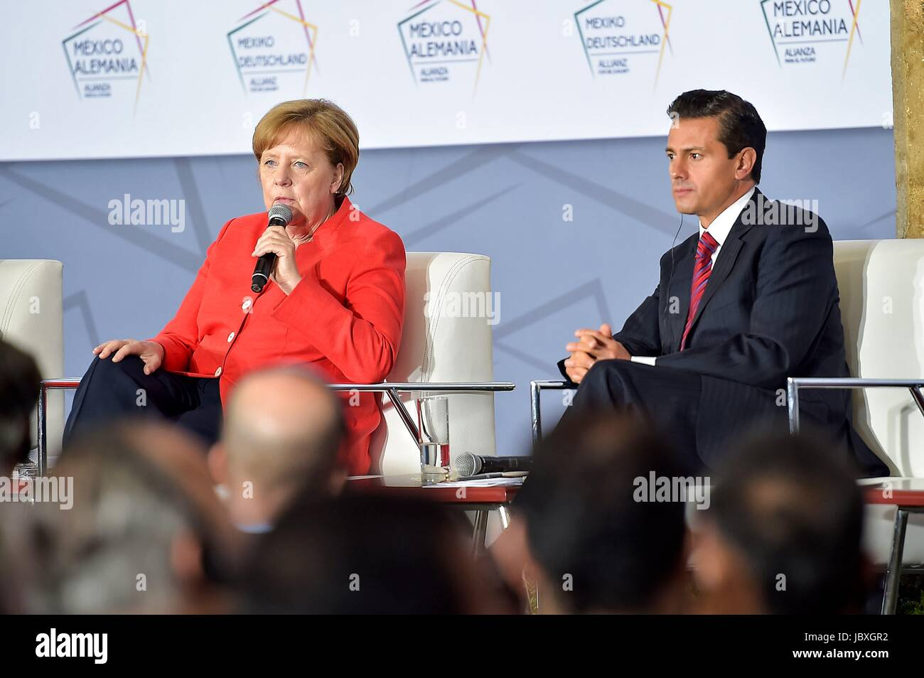 German Chancellor Angela Merkel answers a questions during a meeting with Mexican business leaders as Mexican President - Stock Image