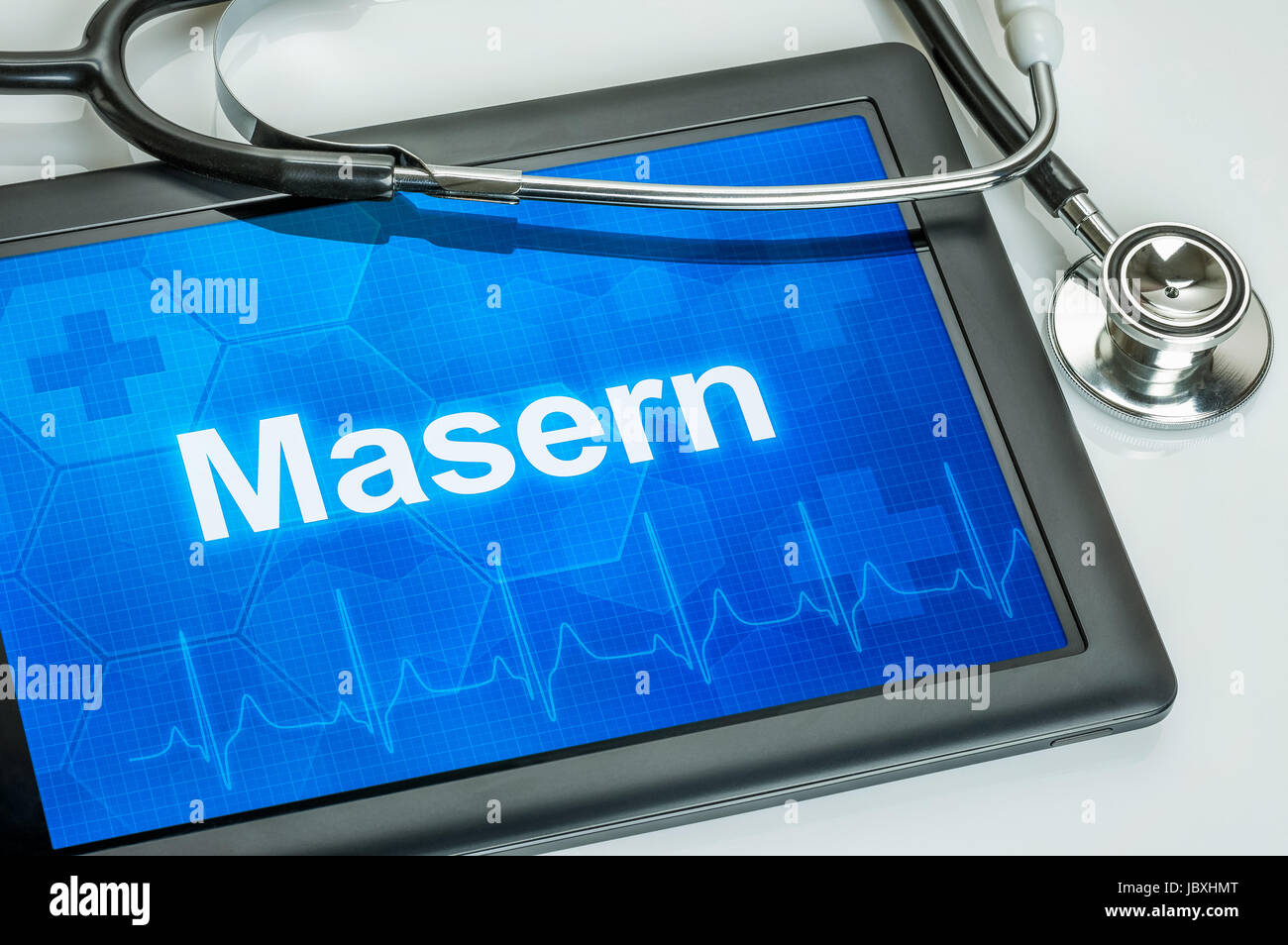 Tablet mit der Diagnose Masern auf dem Display Stock Photo