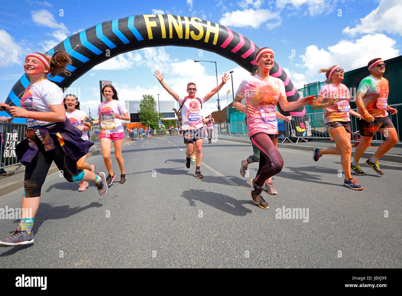 Color Run London, at Wembley Park. Finish arch. Runners. Space for copy - Stock Image