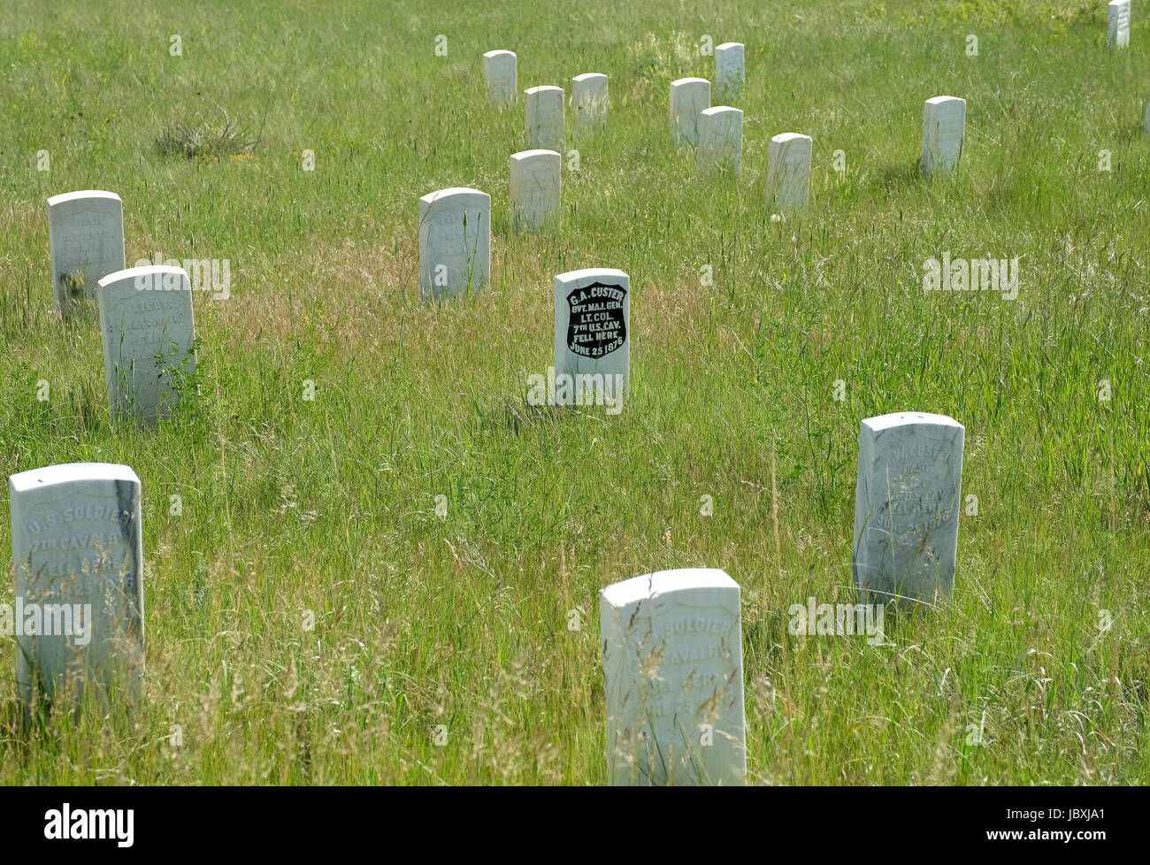 A head stone (black) marks the spot where General George Custer fell at Last Stand Hill during the Battle of Little Bighorn, Montana on July 25 1876. Stock Photo