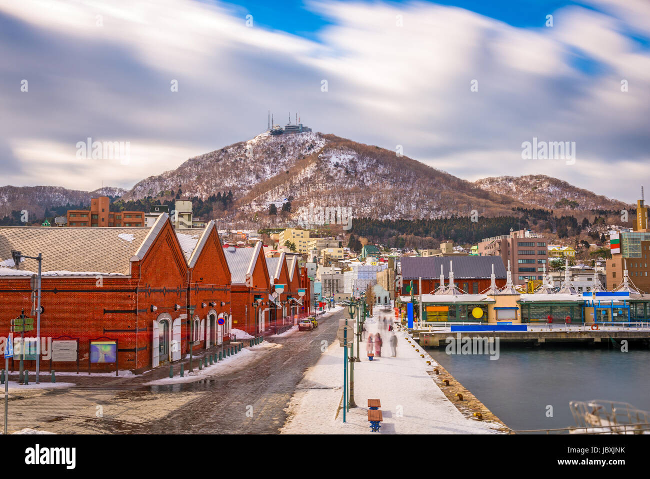 Hakodate, Japan cityscape at the historic Red Brick Warehouses and Mt. Hakodate. - Stock Image