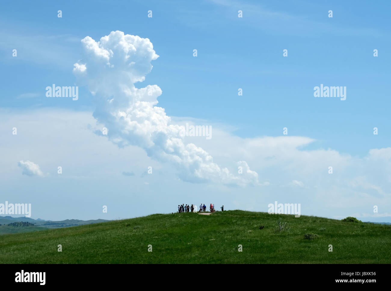 Visitors stand on a high point at the Little Bighorn battlefield site, Crow Agency, Montana, USA. Stock Photo