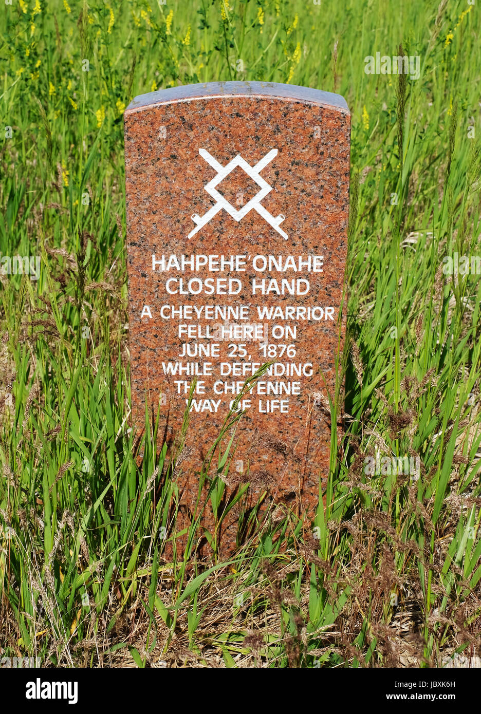 """A head stone marks the spot where Cheyenne Warrior """"Hahpehe Onahe"""" """"Closed Hand"""" fell during the battle of Little Bighorn, Montana, in 1876. Stock Photo"""