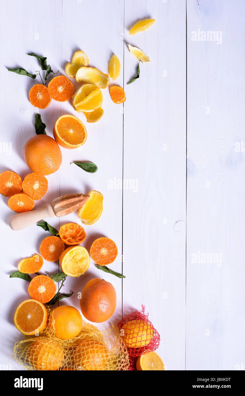 Orange fruit, making orange juice with ripe oranges, white table background. Above view, copy space. - Stock Image