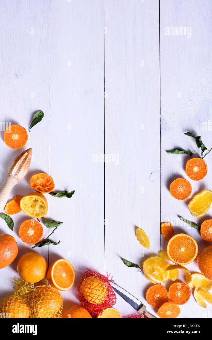 Oranges, ripe fruits freshly picked on a white wooden table, copy space, top view. Stock Photo