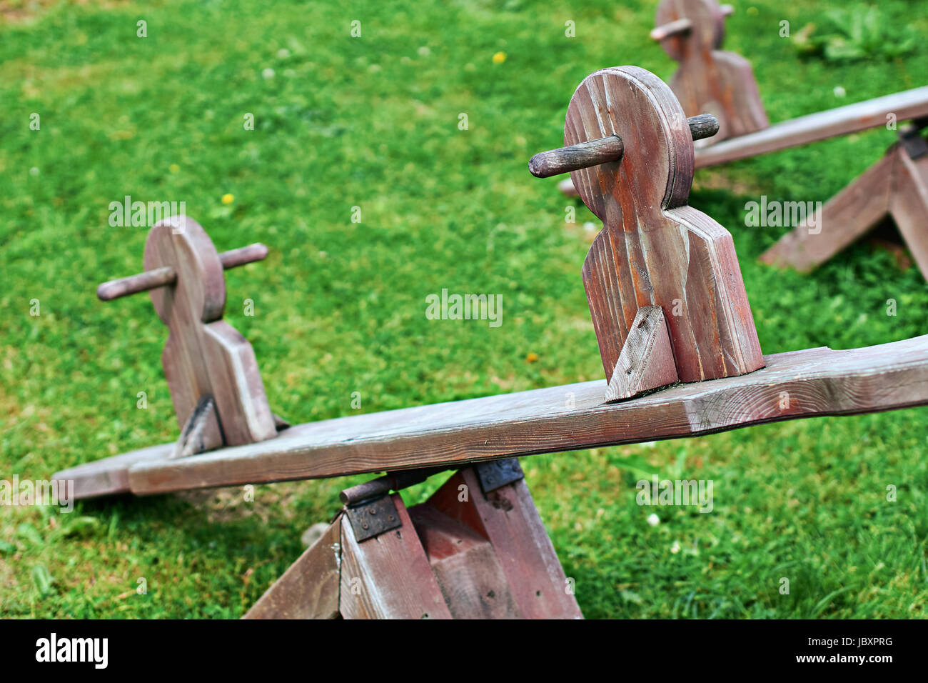 Wooden equipment on kinds playground - Stock Image