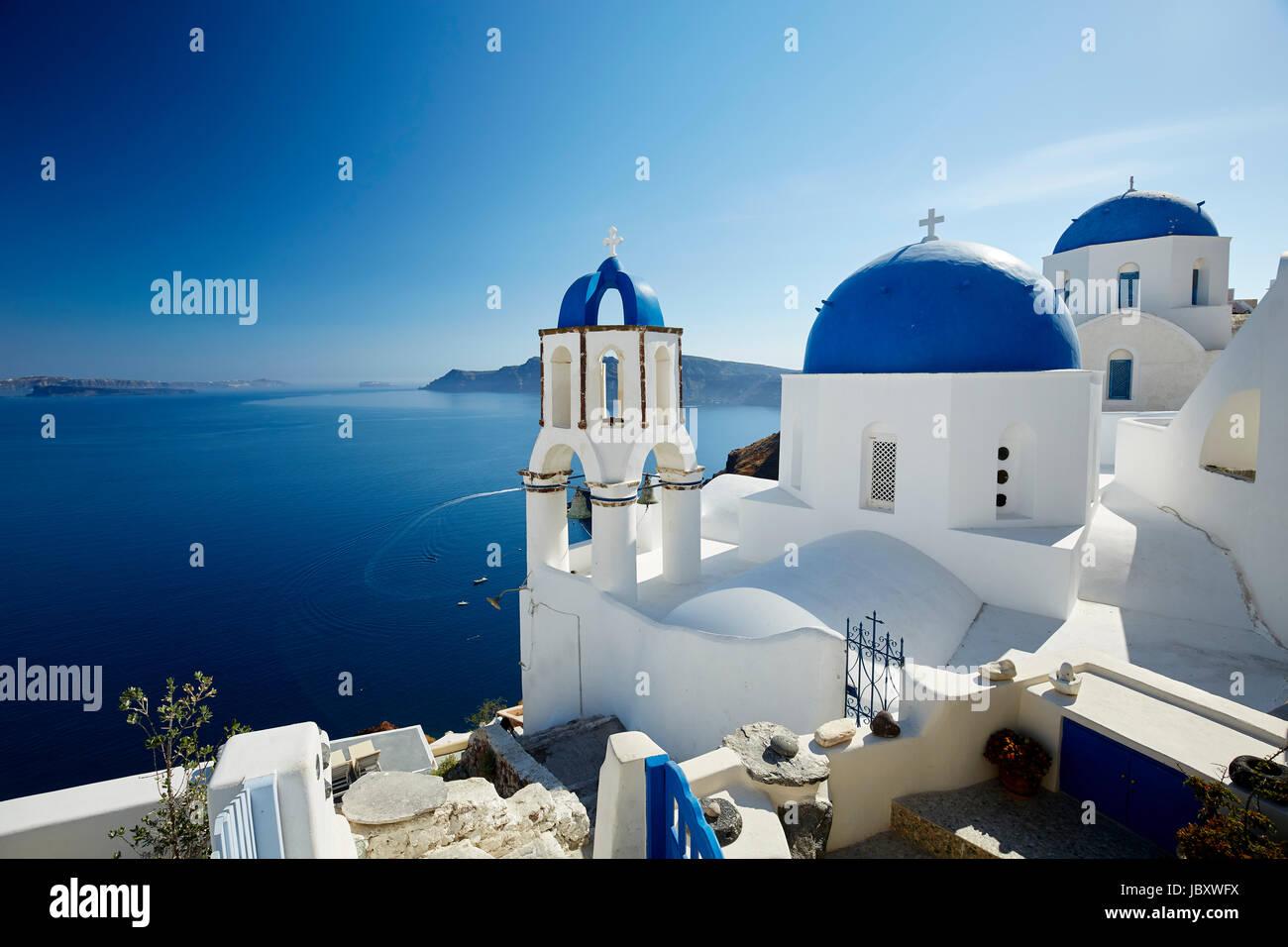 Churches overlooking Oia, Santorini - Stock Image